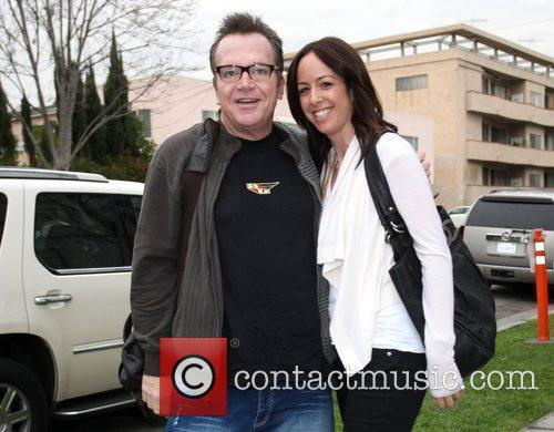 Tom Arnold and A Female Companion 1