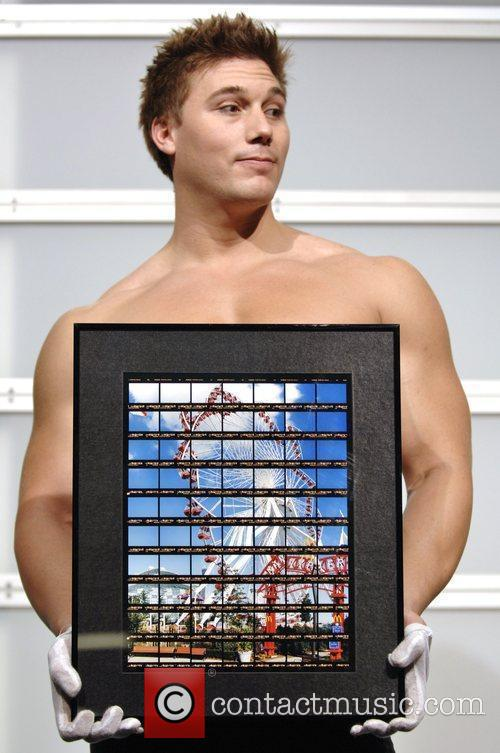 Model presents photo for auction SNAP!09 an annual...