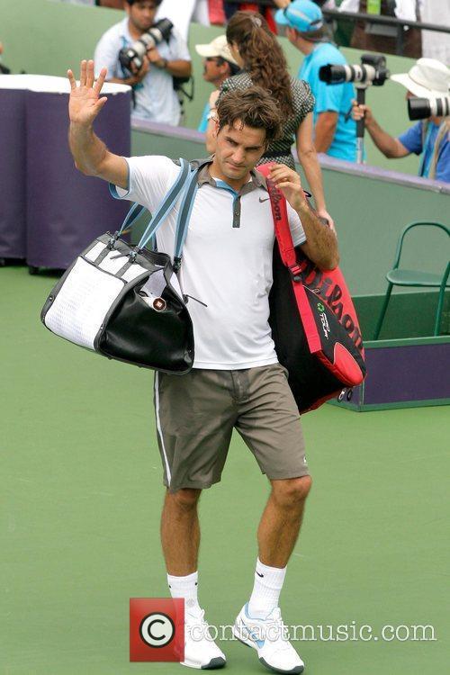 Roger Federer plays in a match against Novak...