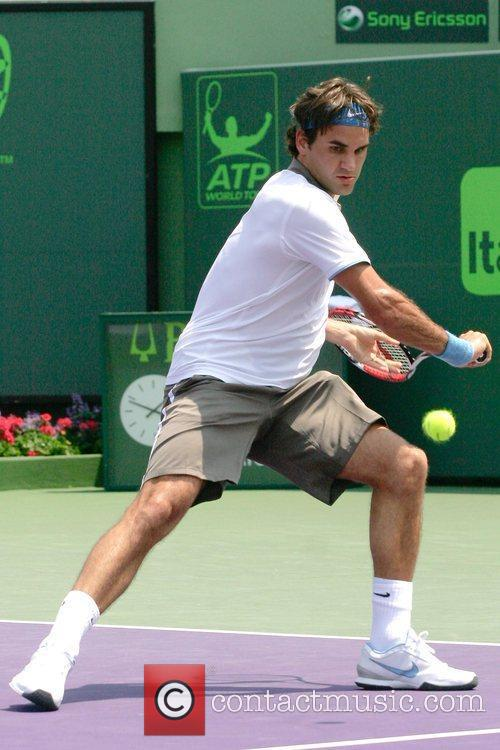 Plays in a match against Novak Djokovic at...