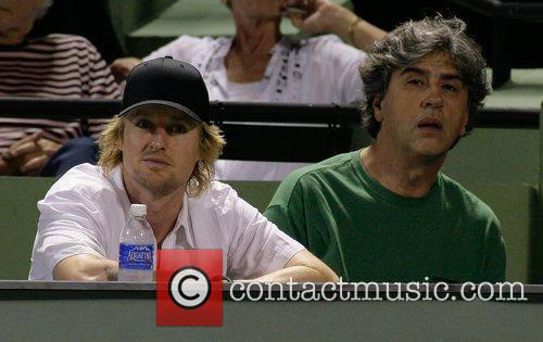 Actor Owen Wilson watches the tennis match between...