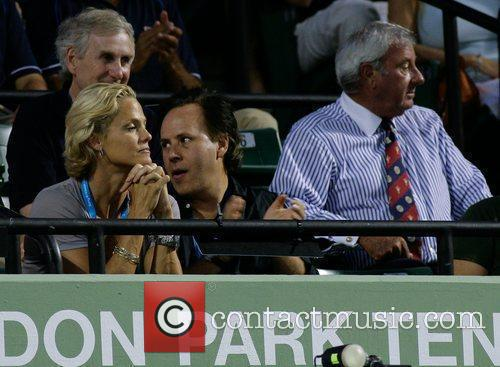 Olympic swimmer Dara Torres  watches the tennis...