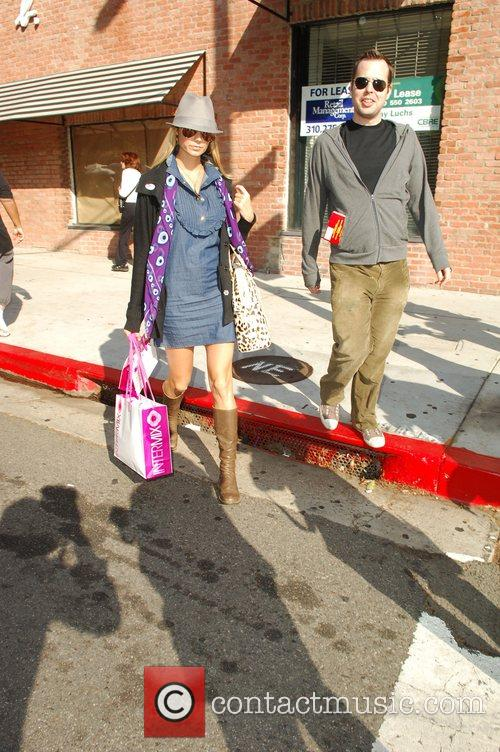 Stacy Keibler leaving Newsroom, carrying an Intermix shopping...