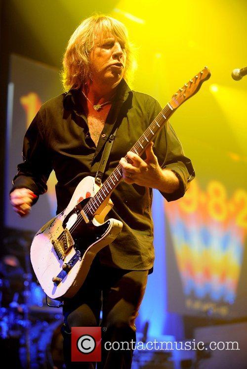 Rick Parfitt of Status Quo performing in concert...