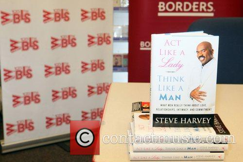 Steve Harvey signs copies of his new book,...