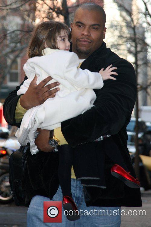 Suri Cruise appears delighted to leave the house,...