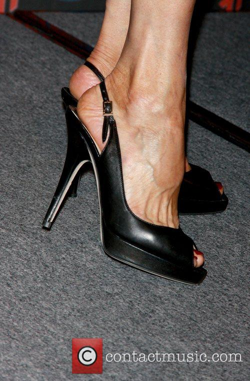 Susan Lucci shows off her shoes as she...