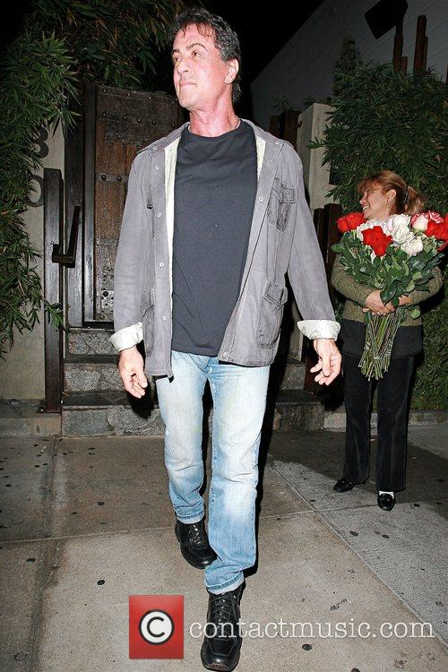 Leaving Koi restaurant after having dinner with his...