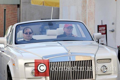 Pulls up in his new Drop-Top Rolls Royce...