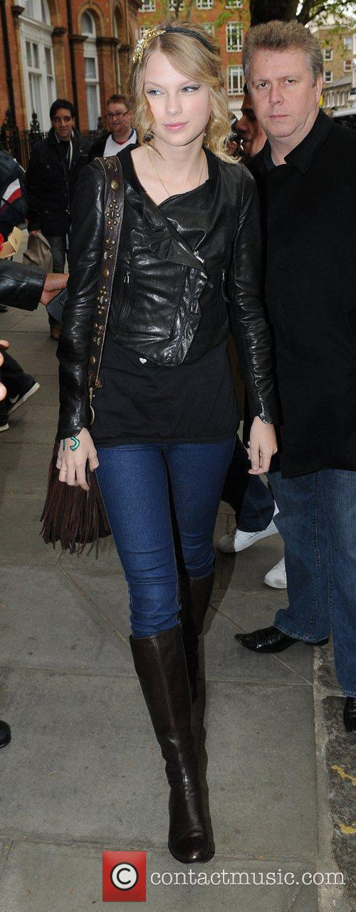 Leaving her hotel wearing a cropped leather jacket...