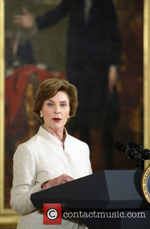 Laura Bush speaks at a gathering in honour...