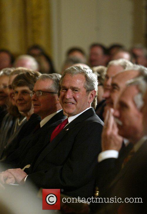 President George Bush speaks at a gathering in...
