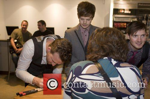 The Feeling sign autographs after their in store...