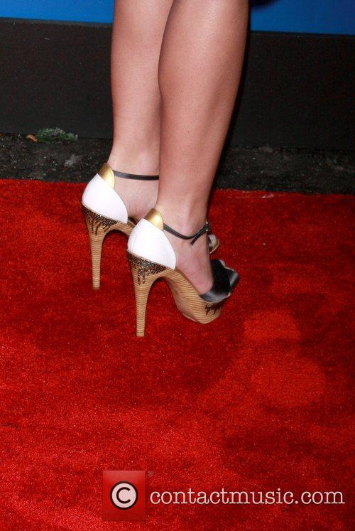Heidi Montag shoes off her shoes as she...
