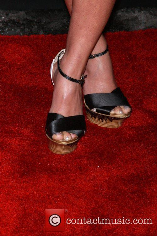 Heidi Montag shows off her shoes as she...