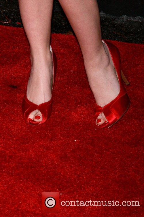 Holly Montag shoes off her shoes as she...