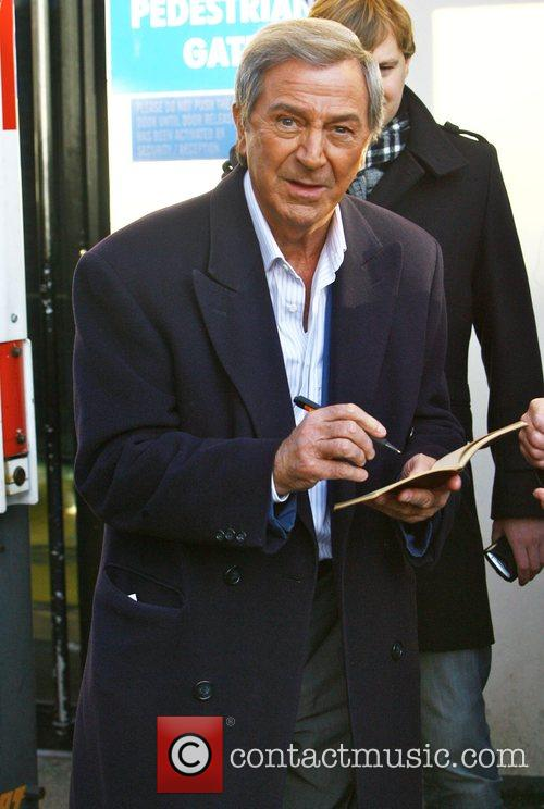 Des O'Connor signs autographs whilst leaving the ITV...