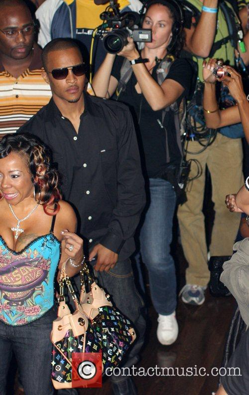 T.I.and his mother attend his album release party...