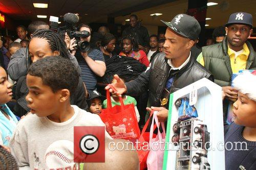 T.I getting into the festive mood gives gifts...