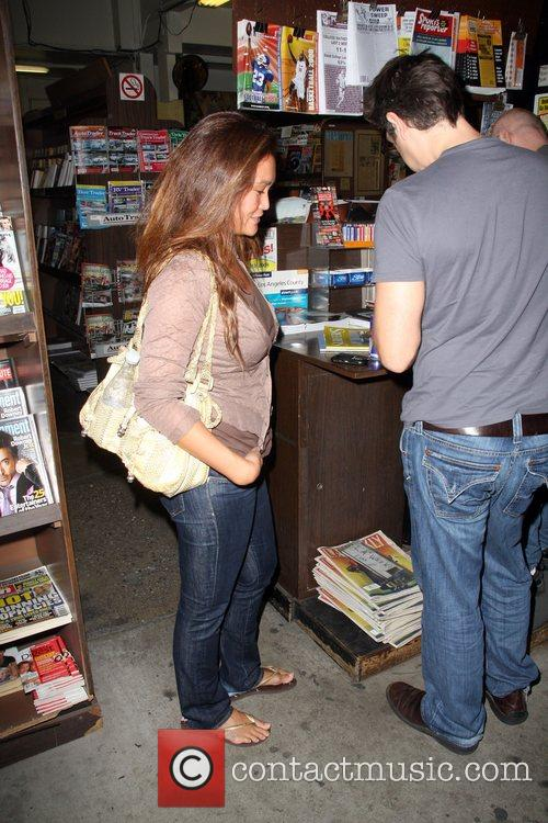 Tia Carrere spotted at a news stand buying...