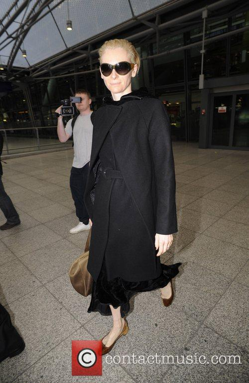 Arrives back at Heathrow airport after returning from...