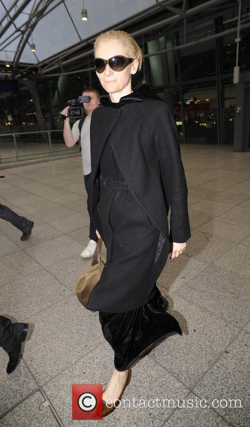 Tilda Swinton arrives back at Heathrow airport after...