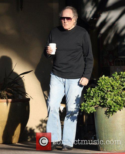 Tobin Bell picks up a Starbucks coffee in...