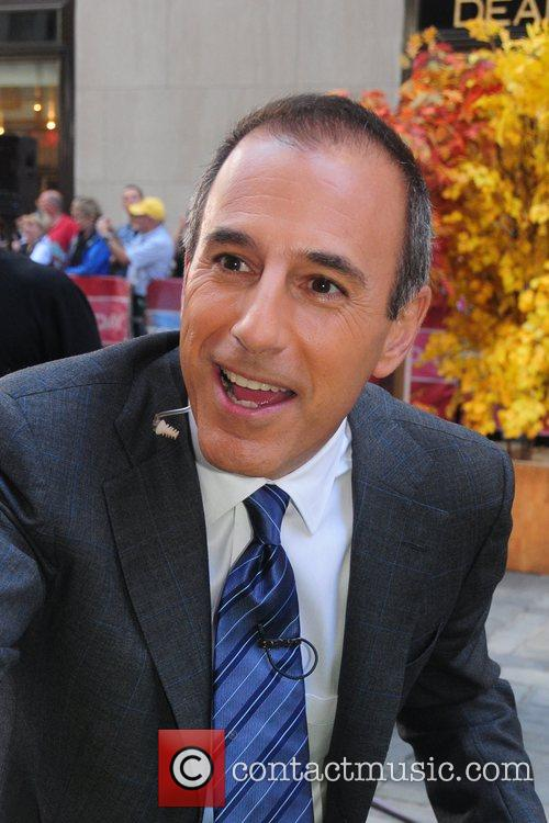 Matt Lauer greets the crowd before shooting a...
