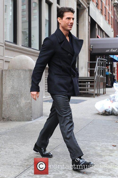 Tom Cruise leaving his Manhattan residence en route...