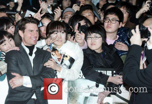 Tom Cruise signs autographs for waiting fans and...