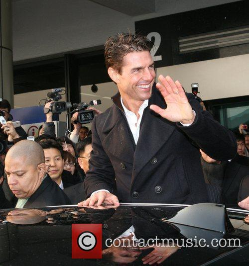 Is greeted by fans as he arrives at...