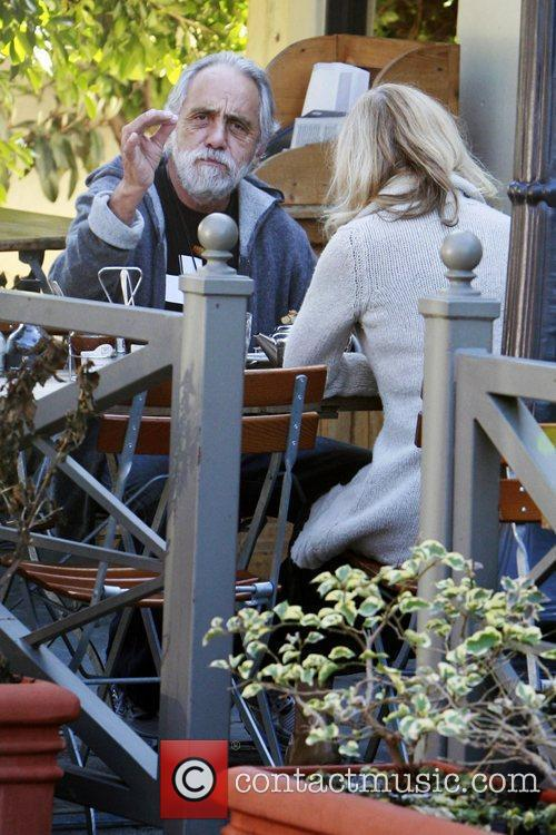 Tommy Chong playing with the photographers as he...