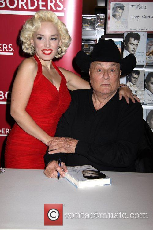 Tony Curtis signs copies of his book 'American...