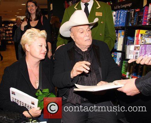 Tony Curtis and Jillann Vanberg Curtis signs copies...