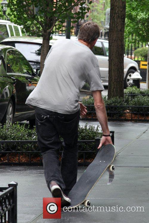 Tony Hawk skateboards for photographers outside his hotel...