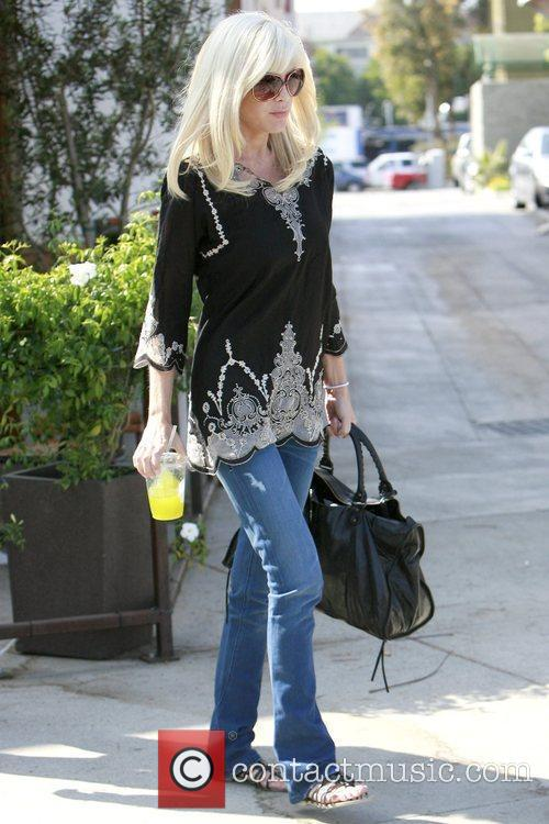 Tori Spelling leaving after having lunch at a...