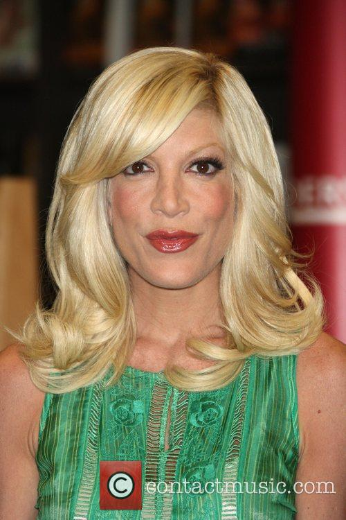 Tori Spelling signs copies of her new book...