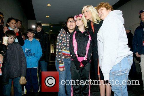 Tori Spelling posing with fans outside NBC studios...