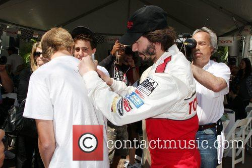 Keanu Reeves signing autographs The Toyota Pro/Celeb Race...