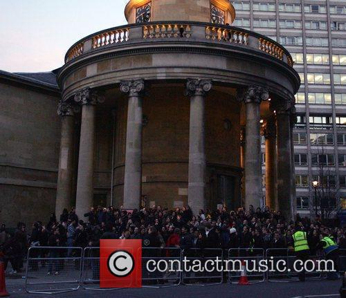 U2 fans wait outside BBC Broadcasting house after...