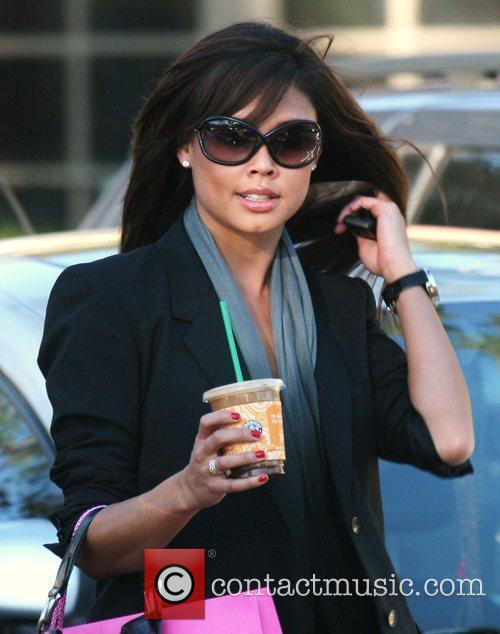 Leaves a Starbucks coffee in Bel Air