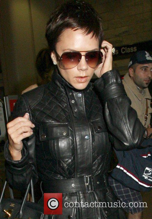 Seen arriving at LAX airport, wearing black leather...