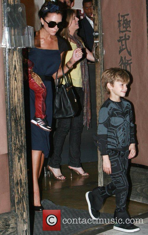Victoria Beckham and her son Cruz leaving his...