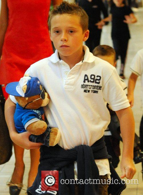 Brooklyn Beckham visits a toy store with his...