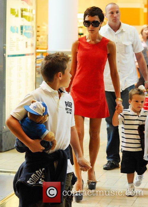 Brooklyn Beckham, Victoria Beckham and Cruz Beckham visit...