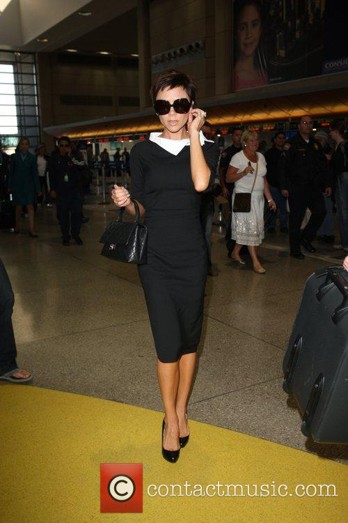 Victoria Beckham seen arriving at LAX Airport boarding...