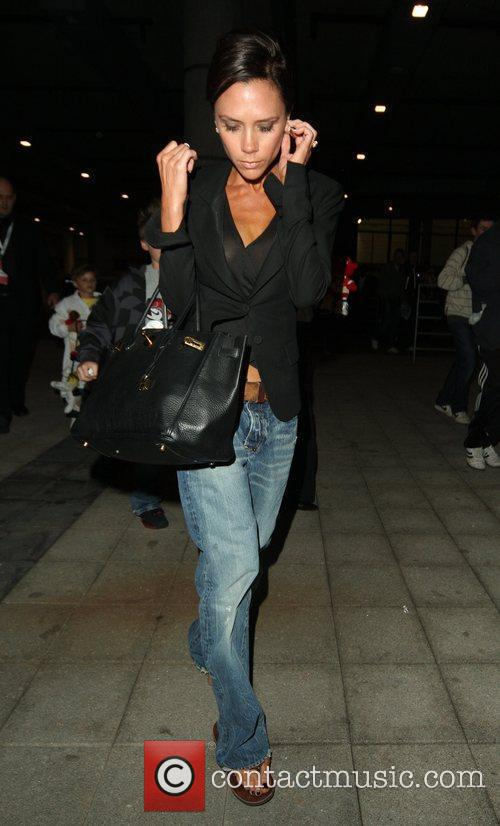 Victoria Beckham leaving Wembley Stadium wearing jeans and...