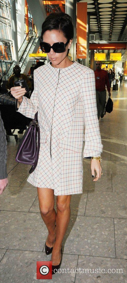 Victoria Beckham arrives at London's Heathrow Airport after...