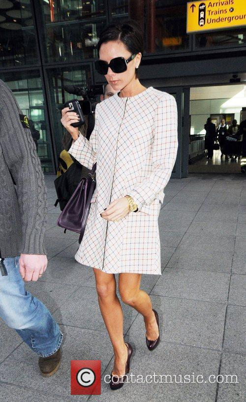Arrives at London's Heathrow Airport after flying in...
