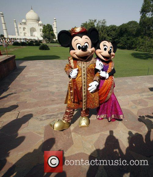 Mickey Mouse and Minnie Mouse  pose at...